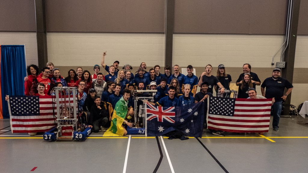 Multiple teams displaying robots with American and Australian flag